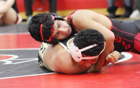 Scout wrestlers four-peat, defend Butler County crown