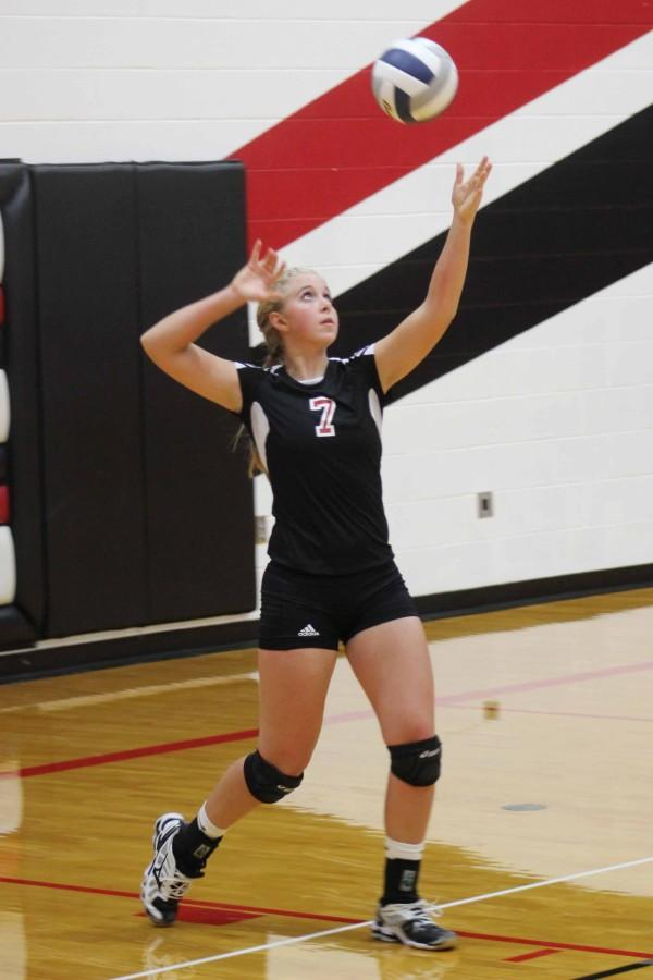 Macy+G.+serves+the+ball+during+the+first+set+of+the+Fillmore+Central+game.+Macy+G.+contributed+one+service+ace+to+the+team%E2%80%99s+six+service+aces+during+the+game.+