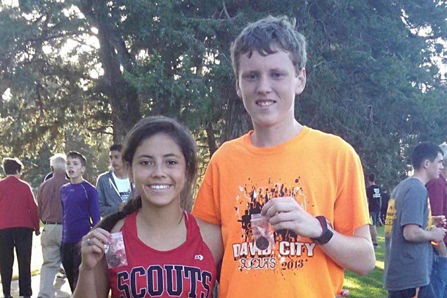 Junior+Alesha+R.+and+senior+Konner+M.+show+off+their+medals+following+the+district+cross+country+meet.+Both+runners+competed+at+State+on+Oct.+24.