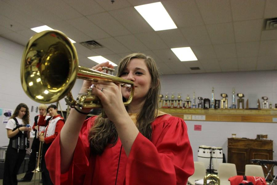 Freshman+Bethany+T.+practices+her+trumpet+part+for+band+while+dressed+in+her+choir+robe.+Bethany+T.+was+one+of+two+awarded+with+a+Concordia+Honor+for+choir.