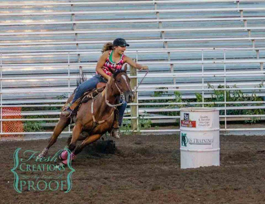 Darting+past+her+second+barrel%2C+junior+Abby+E.+and+her+horse%2C+Peanut%2C+place+third+at+a+Madison+barrel+racing+competition.+When+racing%2C+Abby+prefers+to+head+toward+the+right+barrel+first+due+to+the+way+her+horse+has+been+trained.