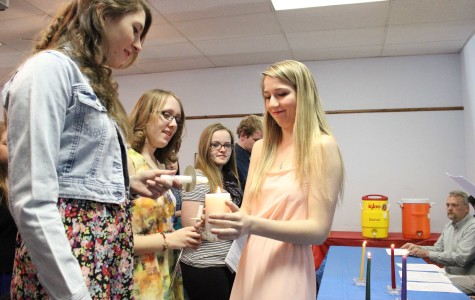 NHS inducts new members, ignites ten torches