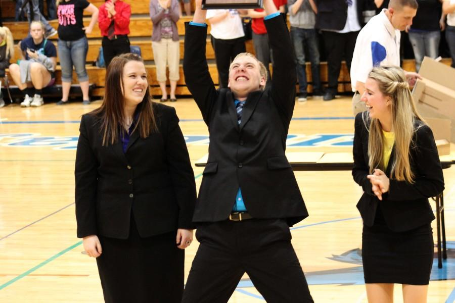 Senior Jake K. is ecstatic to accept the first place trophy at Districts for the speech team. Jake qualified in humorous prose and in duet for the state tournament which will be held at UNK on March 26.