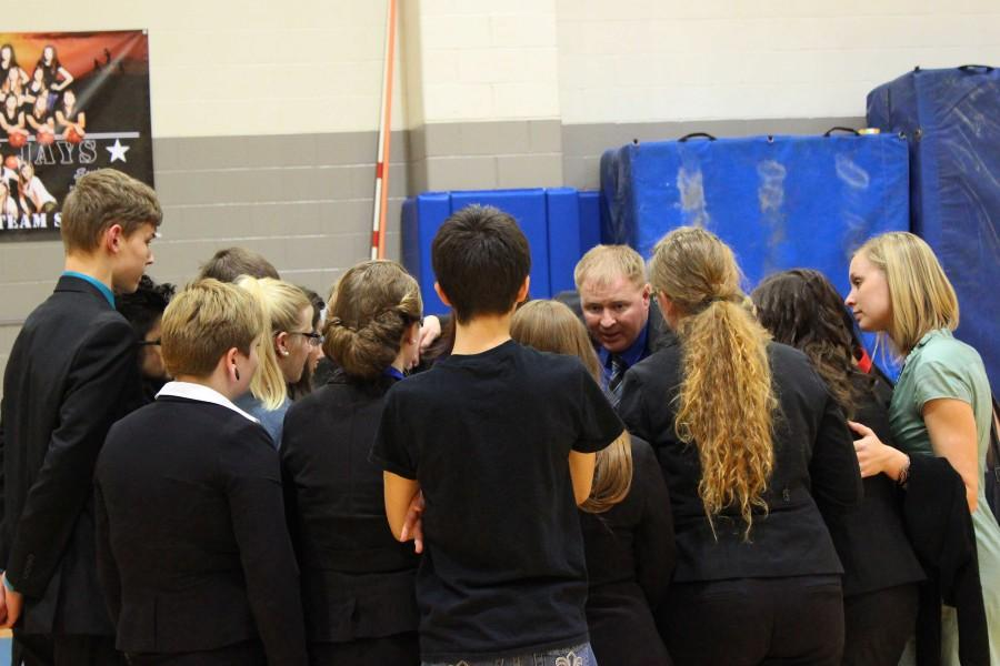 Head coach Jarod Ockander gives the speech team a pep talk after awards at Districts. The Scouts won Districts and qualified 13 events to compete at State.