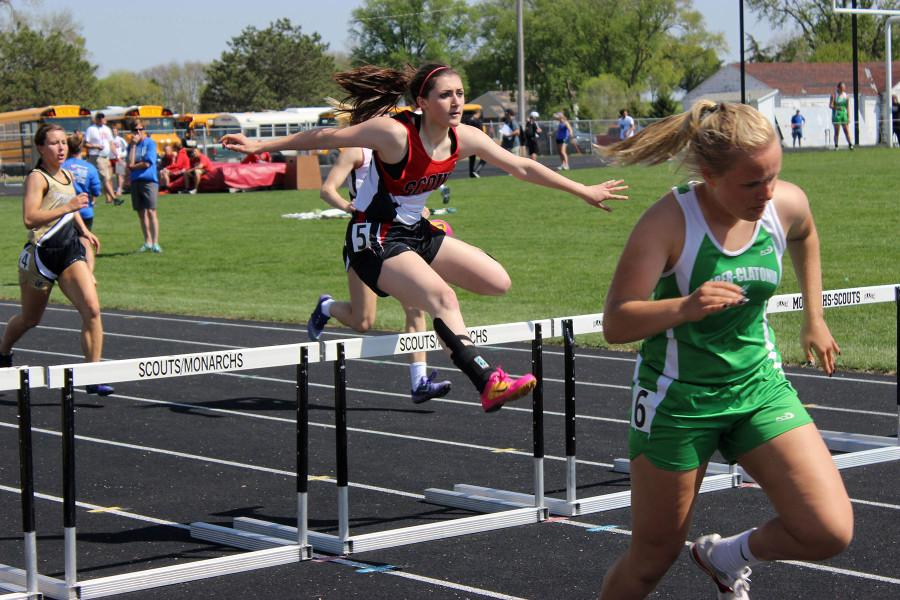 Soaring+over+her+final+hurdle+in+the+300+hurdles%2C+sophomore+Becca+M.+works+her+way+to+the+finish+line+at+the+SNC+Conference+Invite+on+May+2+in+David+City.+Becca+achieved+her+personal+best+time+of+53.49+seconds%2C+moving+her+up+to+seventh+place+on+the+school%E2%80%99s+all-time+depth+chart.