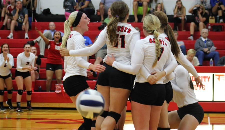 The+Varsity+girls+come+together+as+a+team+after+scoring+a+point.+The+Lady+Scouts+had+a+total+of+14+kills+against+the+Blue+Jays.+