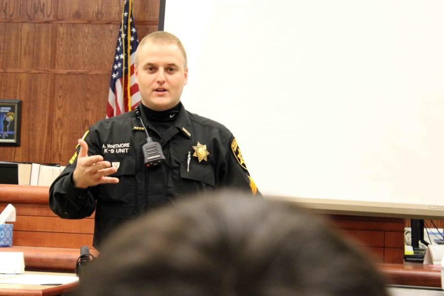 Previewing his drug dog demonstration, Sgt. Anthony Whitmore provides information to students on how drug dogs work. A presentation including a drug dog searching for a hidden rag smelling like methamphetamine followed.
