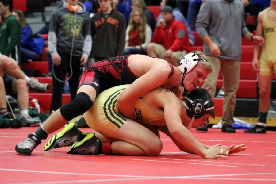 Senior+Dustin+Papa+works+to+break+down+his+opponent%2C+Tucker+Schneiderheinz+from+Central+City+at+the+David+City+Quad+on+Dec.+17.+Papa+won+the+match+by+pin+in+32+seconds.