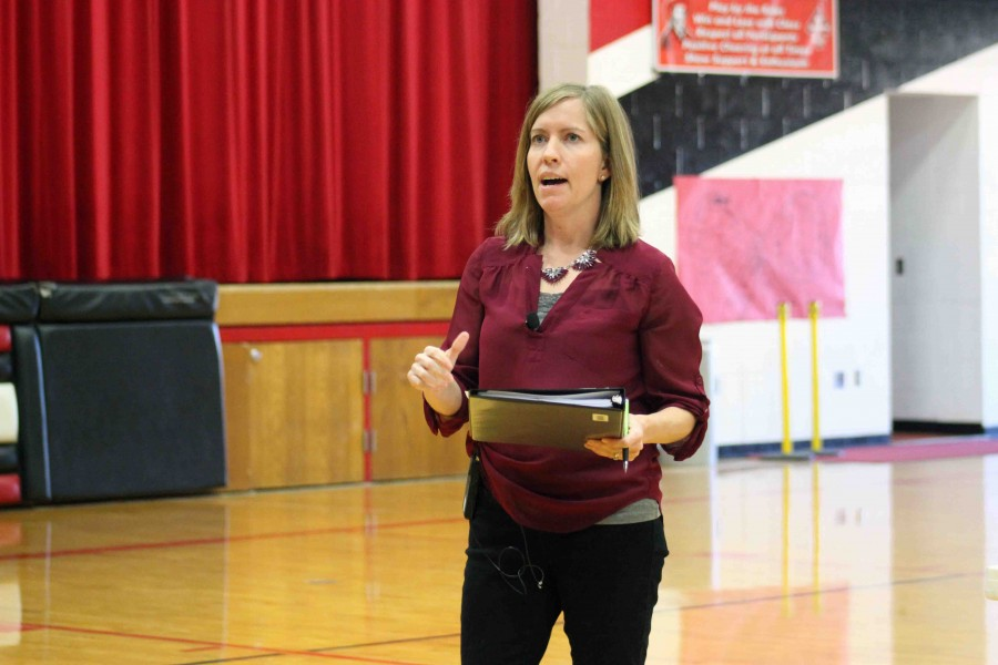 ADK Spelling Bee Committee Member Lisa Bales greets competitors and audience members to the annual Butler County Spelling Bee. Bales has been a member of ADK for eight years.