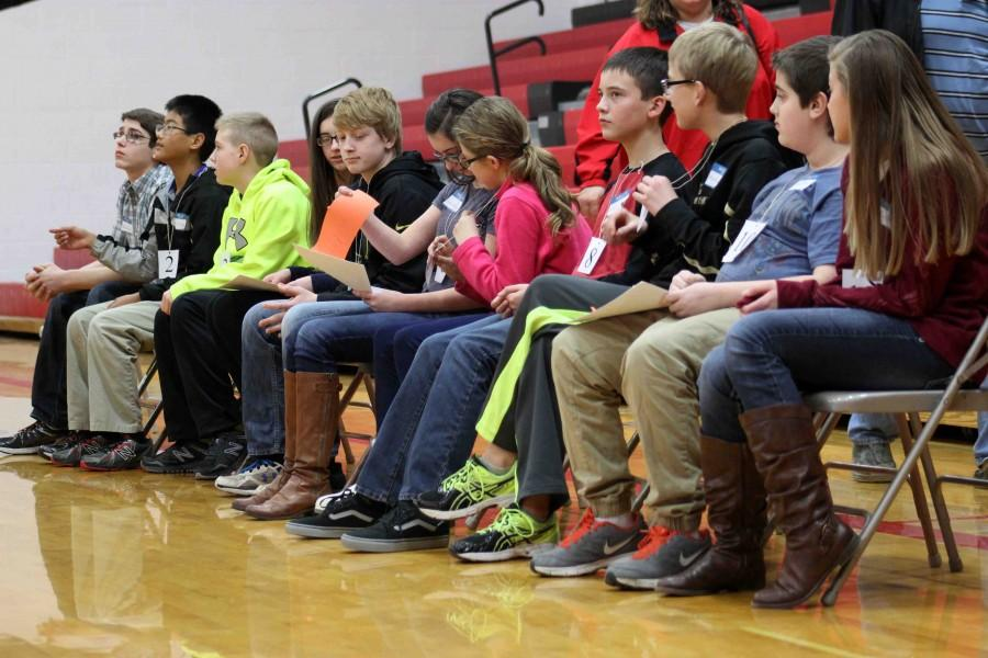 Waiting for the contest to commence, finalists listen to Bales finish instructions for the Bee. After taking the writing test, the top ten finalists advanced into the David City High School Activities Center for the final oral portion of the competition.