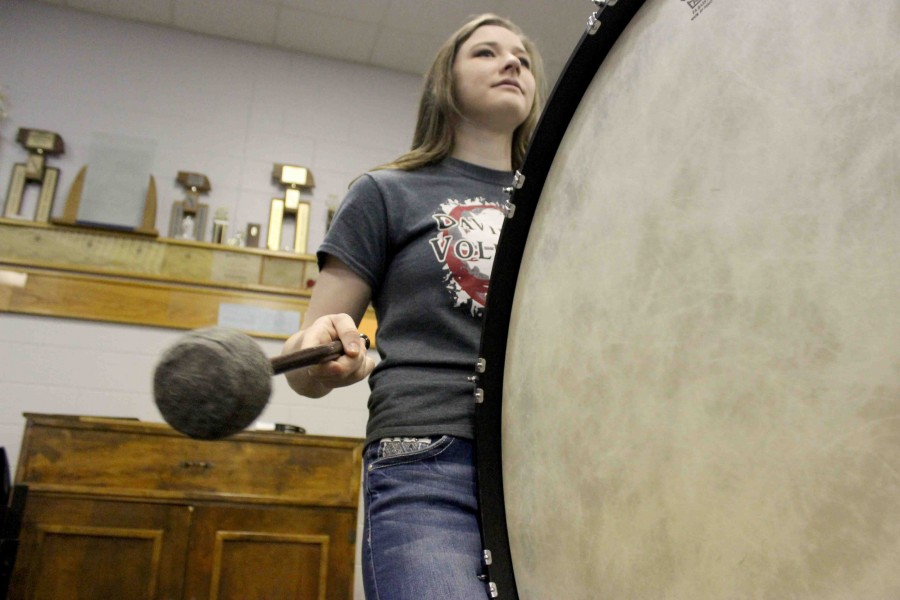 Sophomore Bethany Tebbe performs the percussion's warm-up on the bass drum. Aside from percussion, Tebbe also challenges herself with piano, french horn, trumpet, and vocals.