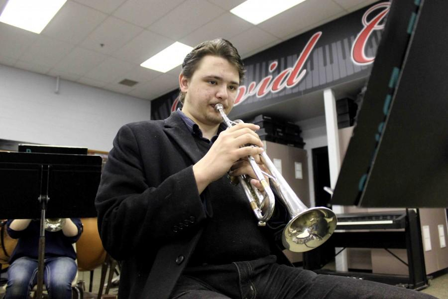"""Senior Matthew Lunde plays """"The Wizard of Oz"""" during one of his many band practices. Not only has he been accepted into multiple honor bands, but he has also been chosen as an alternate for the Nebraska All-State Choir."""