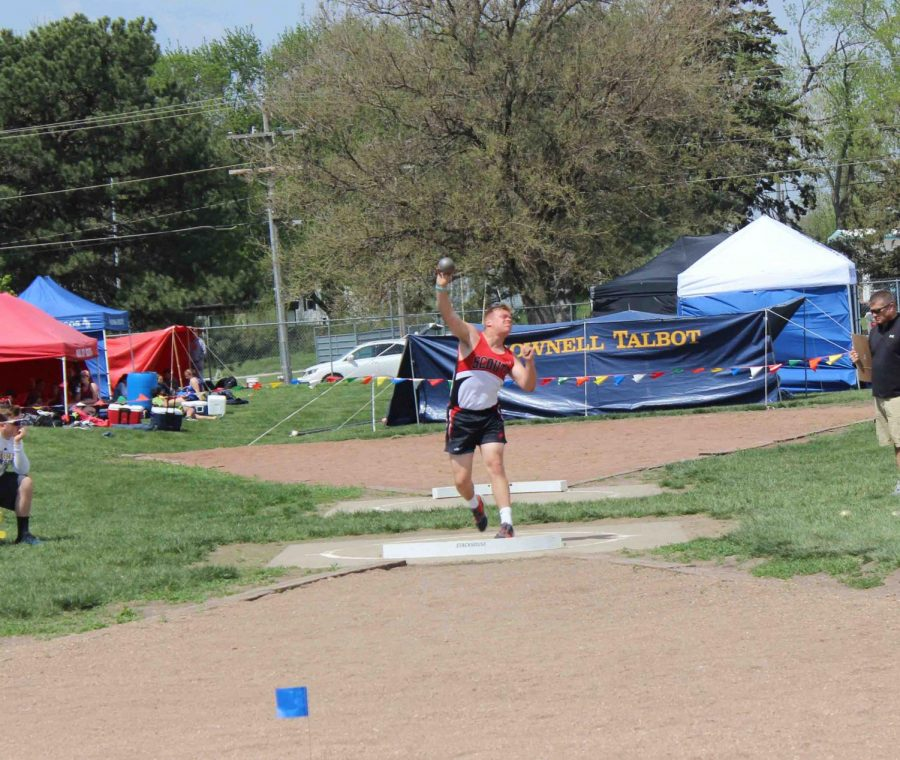 "Senior Colin Vandenberg throws shot put at the District meet hosted by Aquinas Catholic. Vandenberg received fifth with a throw of 42' 05""."