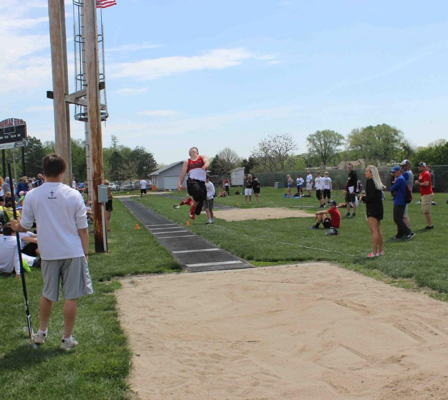 "Sophomore Josh Siebert makes an attempt for State in boys' long jump. Siebert received fourth with a jump of 20' 02""."