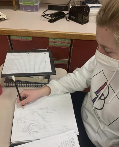 Valori shows off her sketches as she starts a new one.